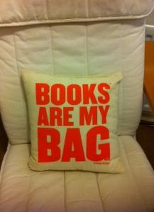 My beautiful books are my bag cushion!